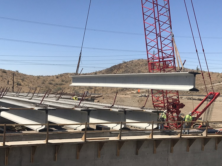 The final bridge girder is placed on the South Mountain Freeway