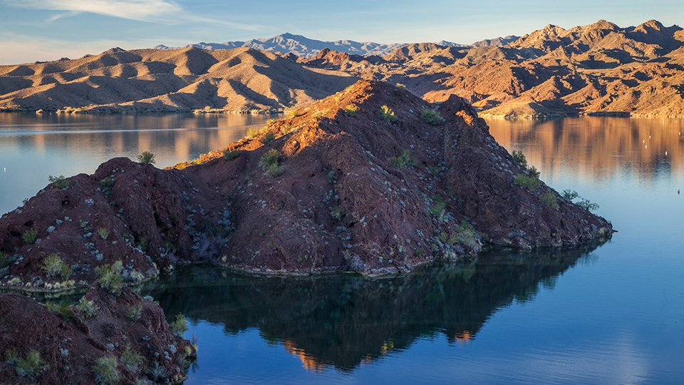 Low-slung buttes rise above the water of Lake Havasu near Parker Dam. | Laurence Parent
