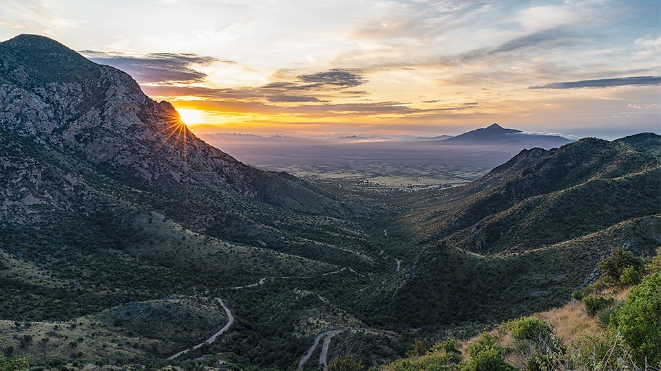 Montezuma Pass at Coronado National Memorial offers a view of sunrise and the twisting road up to the pass. | A.O. Tucker