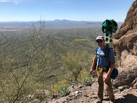 An Arizona State Parks and Trails staff member carries the Google R7 Trekker Camera at Picacho Peak State Park. | Courtesy of Arizona State Parks and Trails