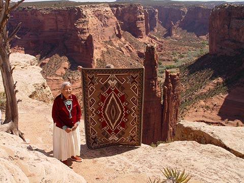 Woman standing by Nizhoni rug